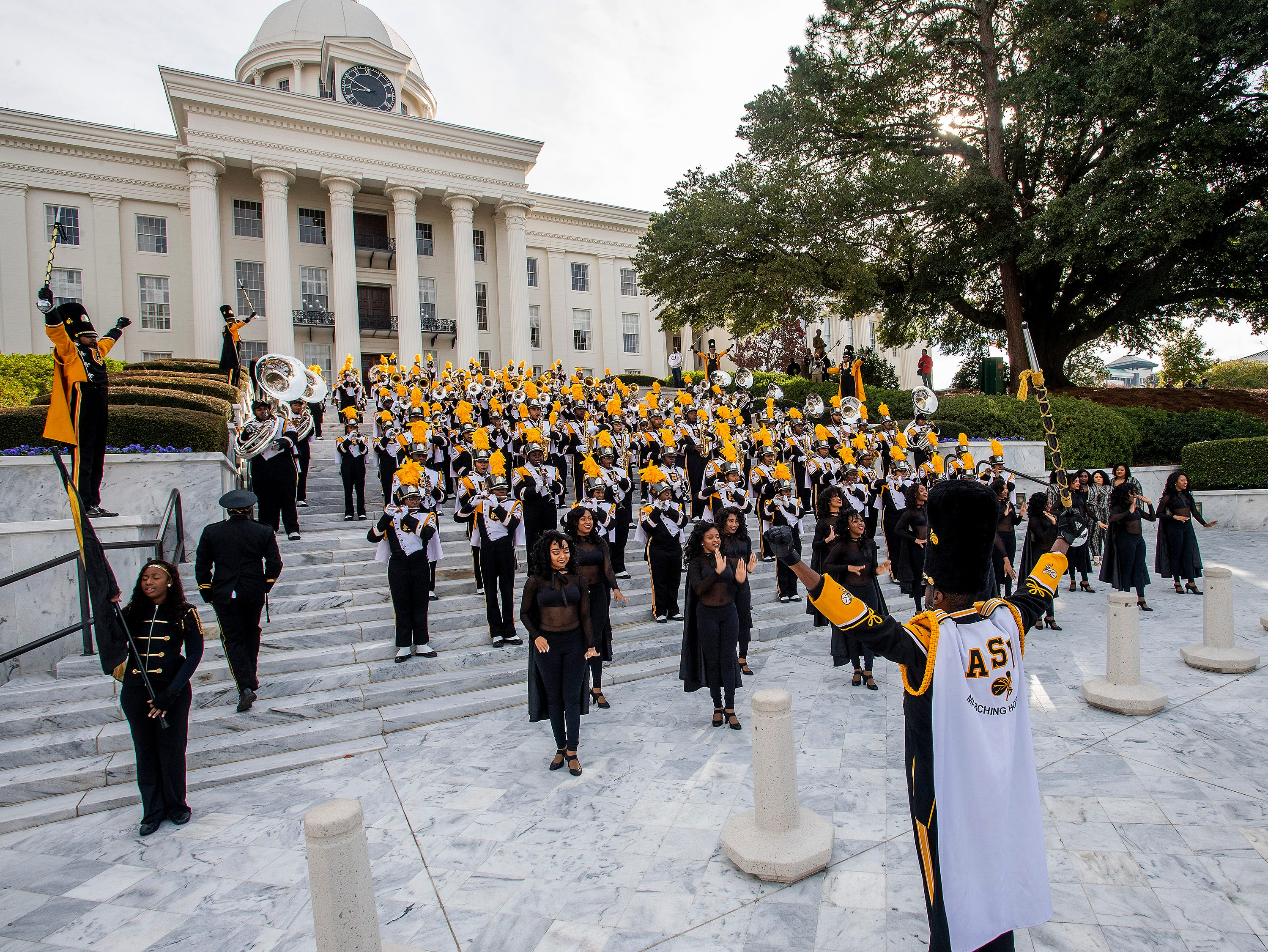 The Alabama State University Marching Hornets perform on the state capitol steps before the Turkey Day Classic Parade in downtown Montgomery, Ala., on Thanksgiving Day, Thursday November 22, 2018.
