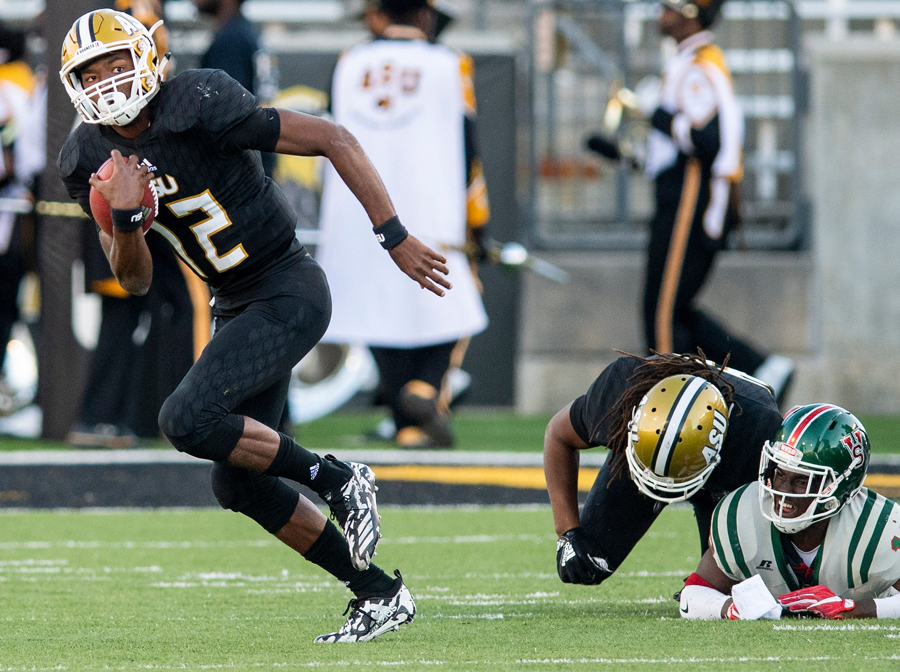 Alabama State University quarterback KHA'Darris Davis (12) carries the ball against Mississippi Valley State in first half action of the Turkey Day Classic at Hornet Stadium on the ASU campus in Montgomery, Ala., on Thanksgiving Day, Thursday November 22, 2018.