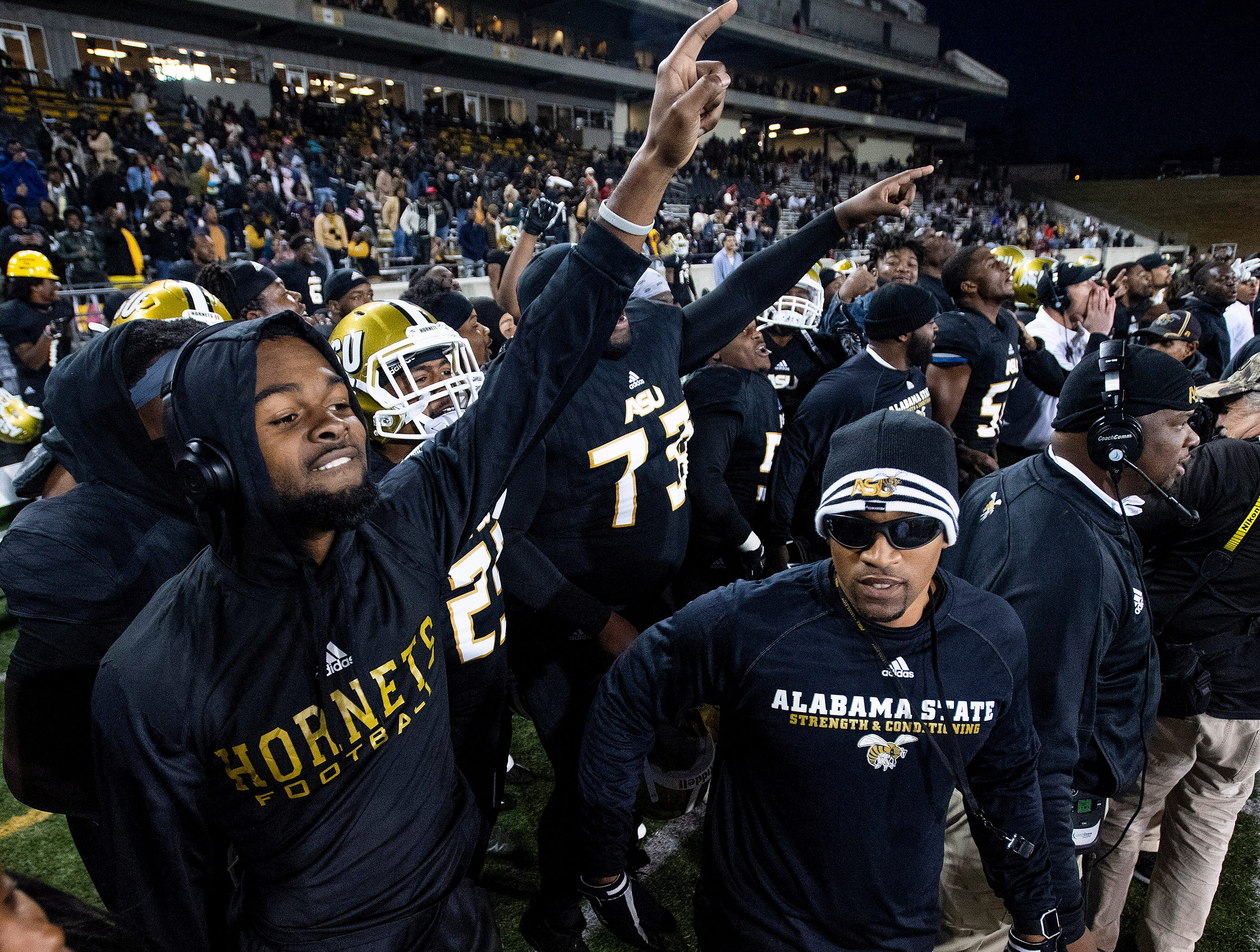 Alabama State University players and staff c celebrate as the clock runs out against Mississippi Valley State in the Turkey Day Classic at Hornet Stadium on the ASU campus in Montgomery, Ala., on Thanksgiving Day, Thursday November 22, 2018.