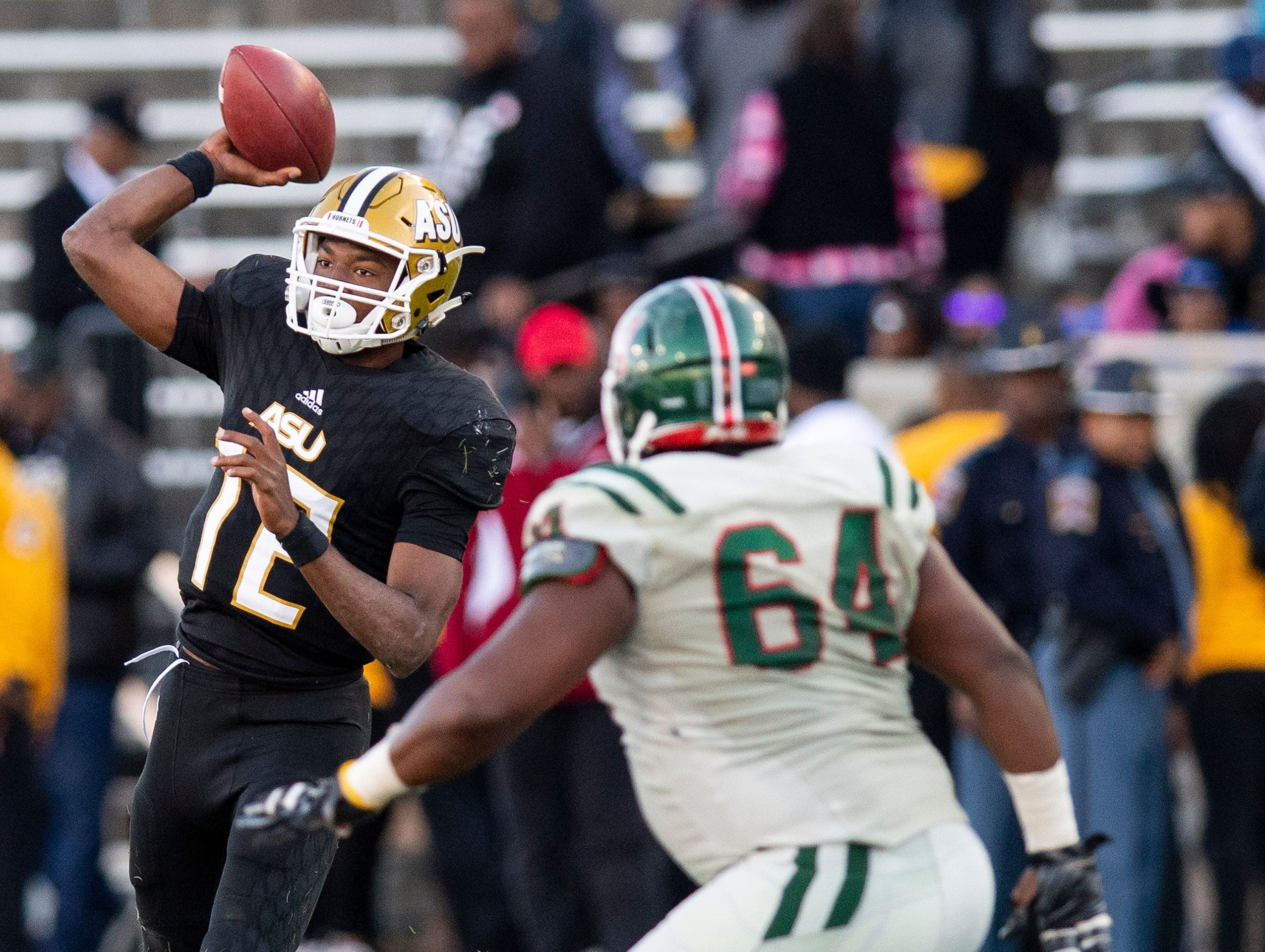 Alabama State University quarterback KHA'Darris Davis (12) passes against Mississippi Valley State in first half action of the Turkey Day Classic at Hornet Stadium on the ASU campus in Montgomery, Ala., on Thanksgiving Day, Thursday November 22, 2018.