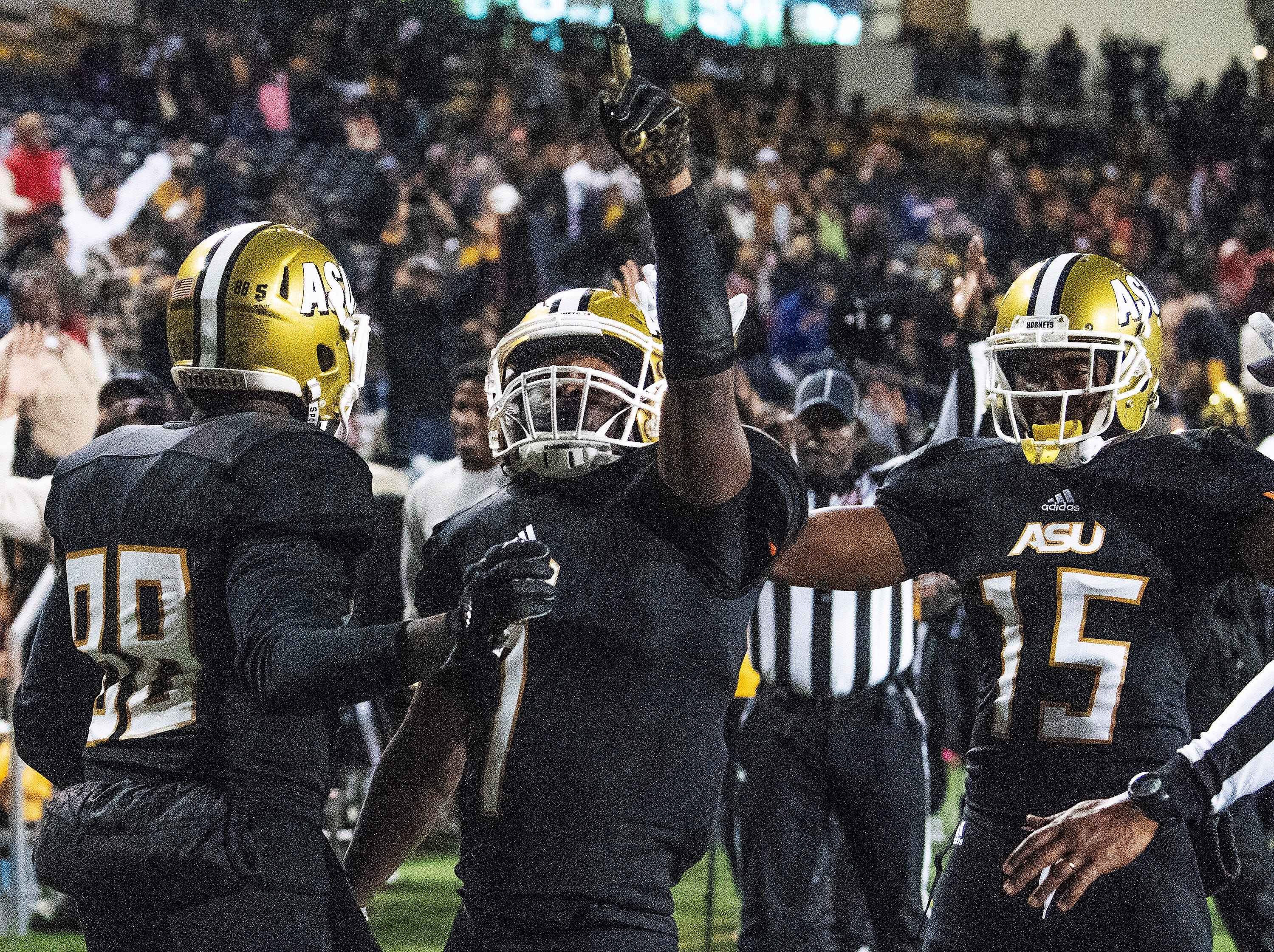 Alabama State University wide receiver Jeremiah Hixon (1)  celebrates his game winning touchdown in overtime against Mississippi Valley State in the Turkey Day Classic at Hornet Stadium on the ASU campus in Montgomery, Ala., on Thanksgiving Day, Thursday November 22, 2018.