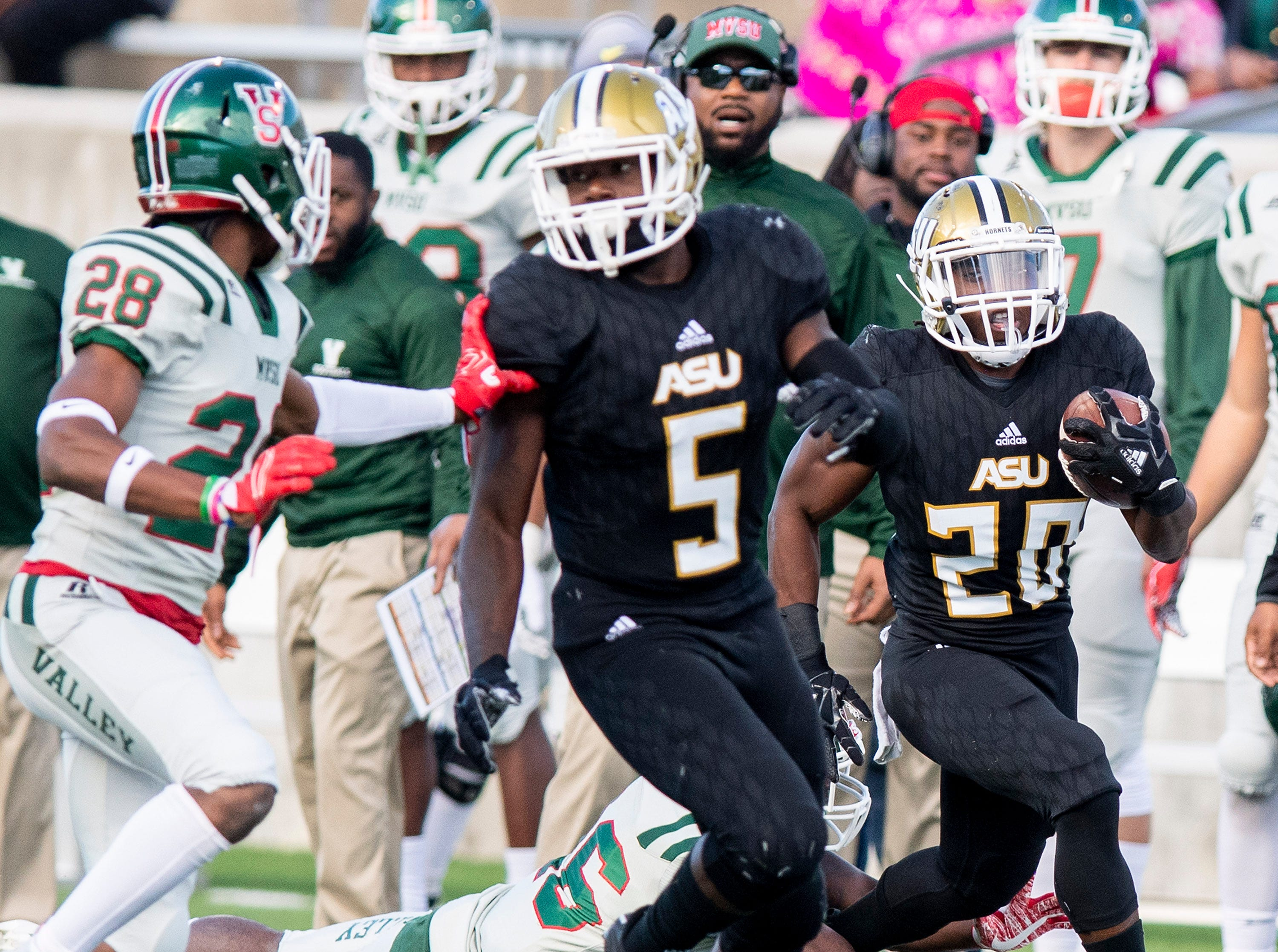 Alabama State University running back Ezra Gray (20) returns a kick behind the blocking of running back Alex Anderson (5) against Mississippi Valley State in first half action of the Turkey Day Classic at Hornet Stadium on the ASU campus in Montgomery, Ala., on Thanksgiving Day, Thursday November 22, 2018.
