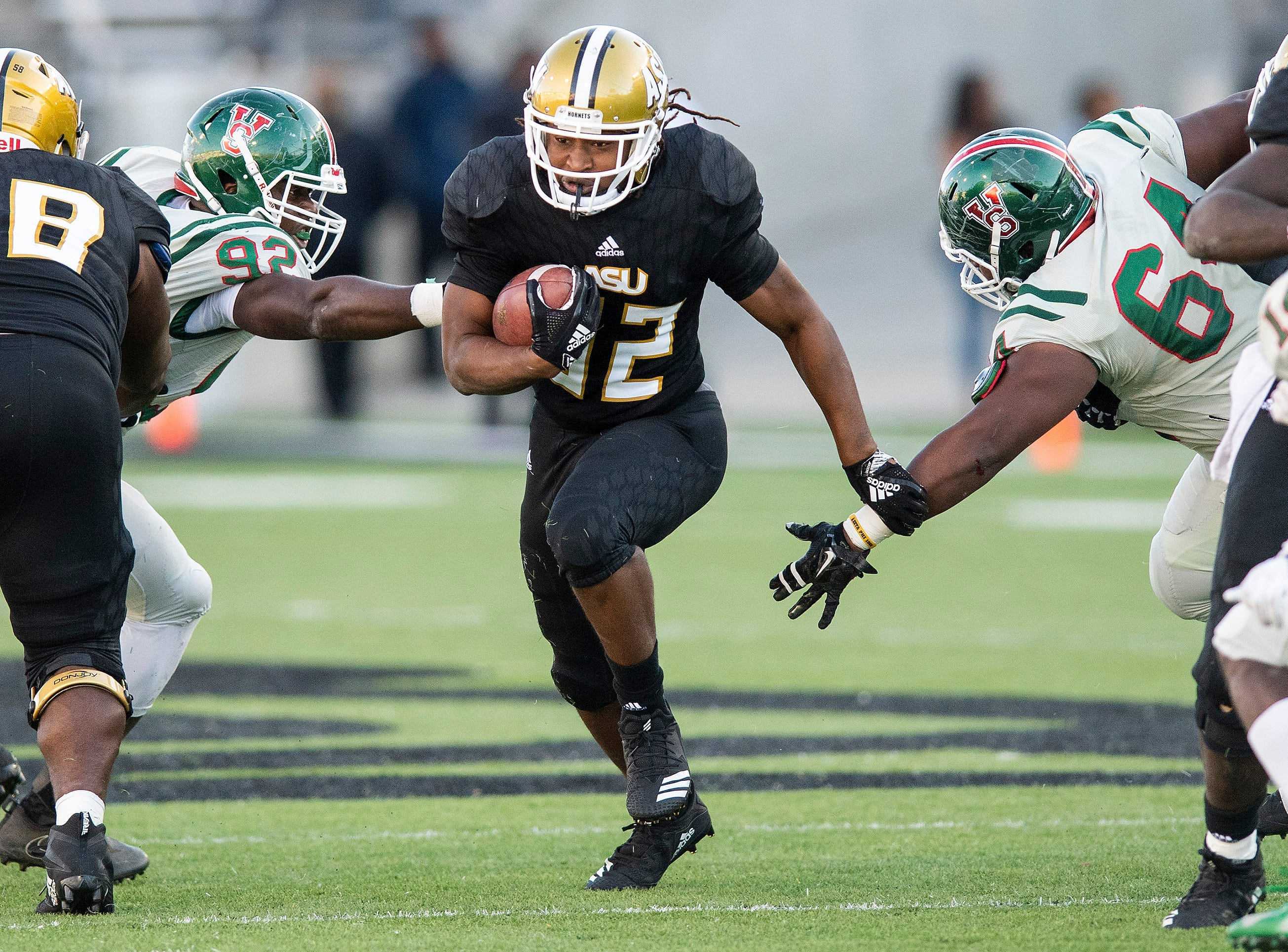 Alabama State University running back Tallesin Farmer (32)  finds running room against Mississippi Valley State in first half action of the Turkey Day Classic at Hornet Stadium on the ASU campus in Montgomery, Ala., on Thanksgiving Day, Thursday November 22, 2018.