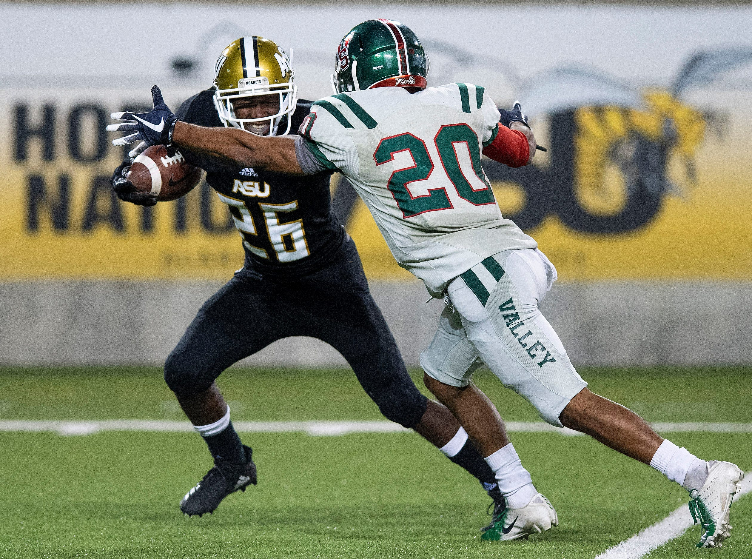 Alabama State University defensive back Kimar Martin (26) intercepts a pass late in the game against Mississippi Valley State in the Turkey Day Classic at Hornet Stadium on the ASU campus in Montgomery, Ala., on Thanksgiving Day, Thursday November 22, 2018.