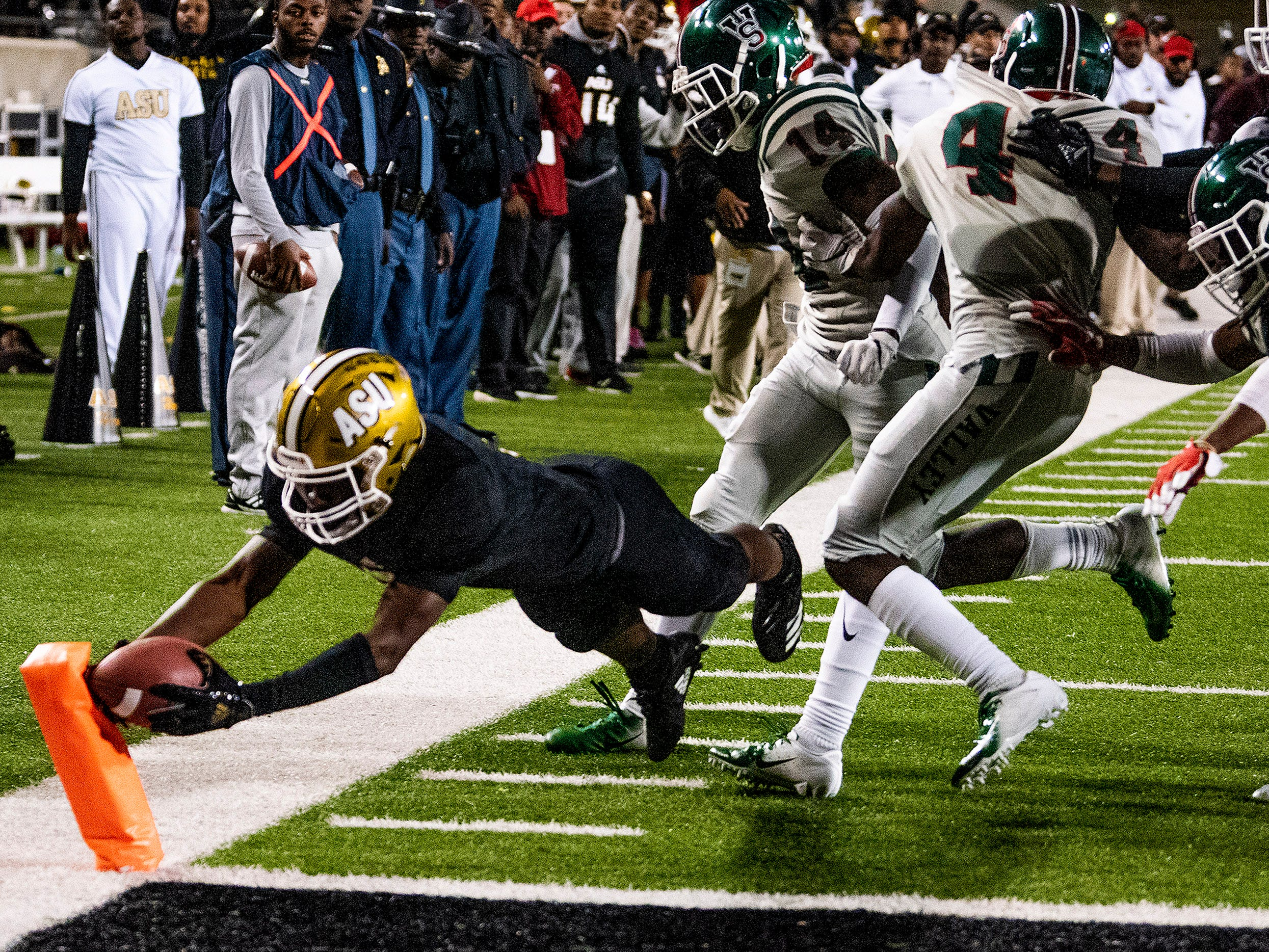 Alabama State University wide receiver Jeremiah Hixon (1)  dives for the pylon as he scores the game winning touchdown in overtime against Mississippi Valley State in the Turkey Day Classic at Hornet Stadium on the ASU campus in Montgomery, Ala., on Thanksgiving Day, Thursday November 22, 2018.