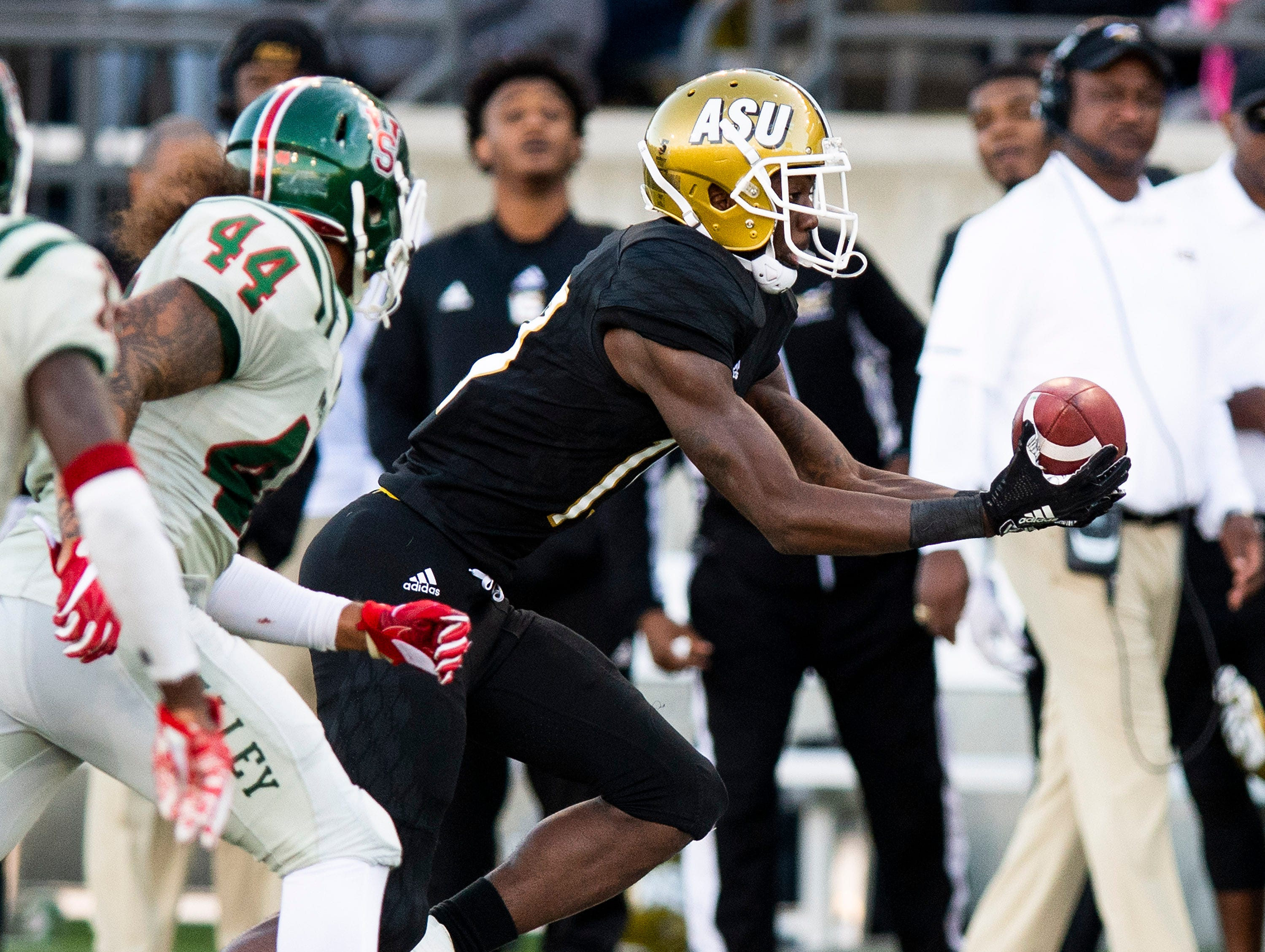Alabama State University wide receiver Michael Jefferson (19)  scoops up an Alabama State fumble and carries it for a gain again st Mississippi Valley State in first half action of the Turkey Day Classic at Hornet Stadium on the ASU campus in Montgomery, Ala., on Thanksgiving Day, Thursday November 22, 2018.