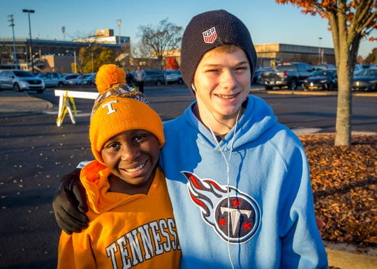 Erza and Knox Wosser take part in the Thanksgiving Day Borodash, a 4-mile walk/run through historic Murfreesboro.
