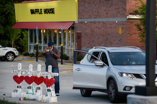 Thurman Hobson Jr., 71, of Memphis stopped to take a picture of the crosses in honor of the four victims killed at the Waffle House, Thursday, July 19, 2018.