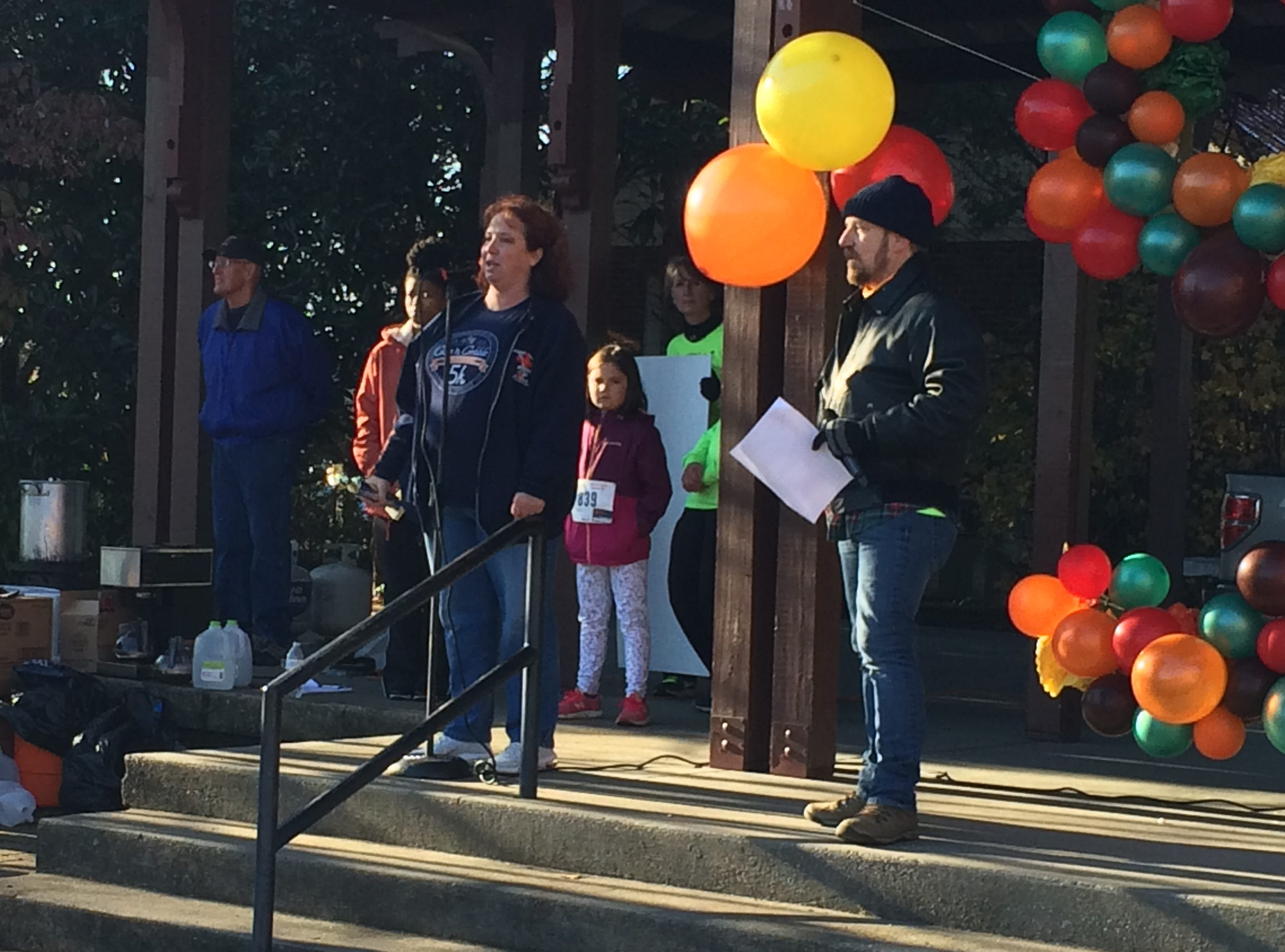 Dickson County Help Center Director Renee Boehm talks to the crowd at the Give N Gobble.