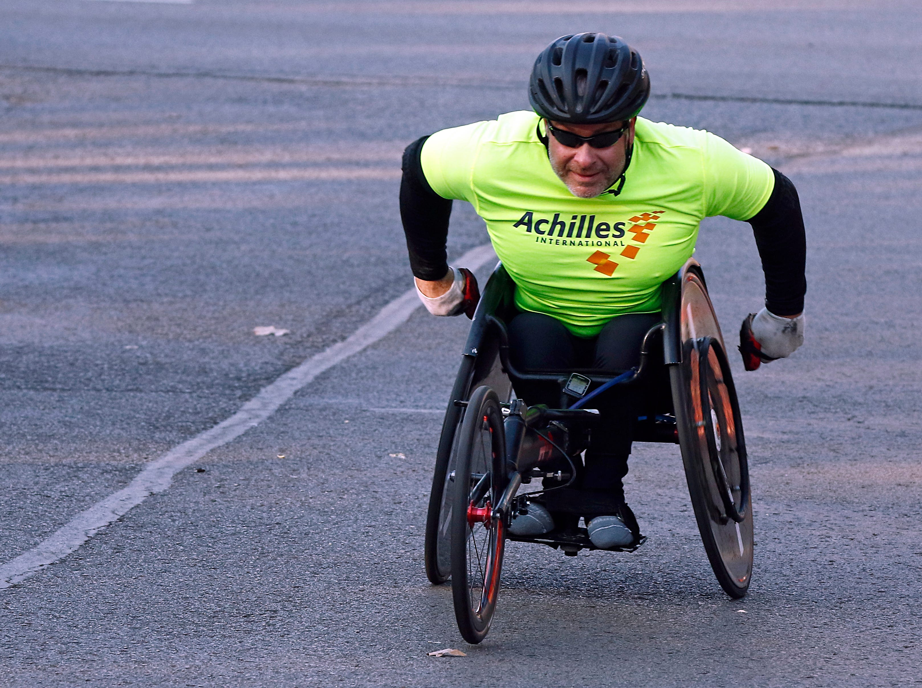 A wheelchair racer makes his way along the course during the annual Boulevard Bolt Thursday, Nov. 22, 2018, in Nashville, TN.
