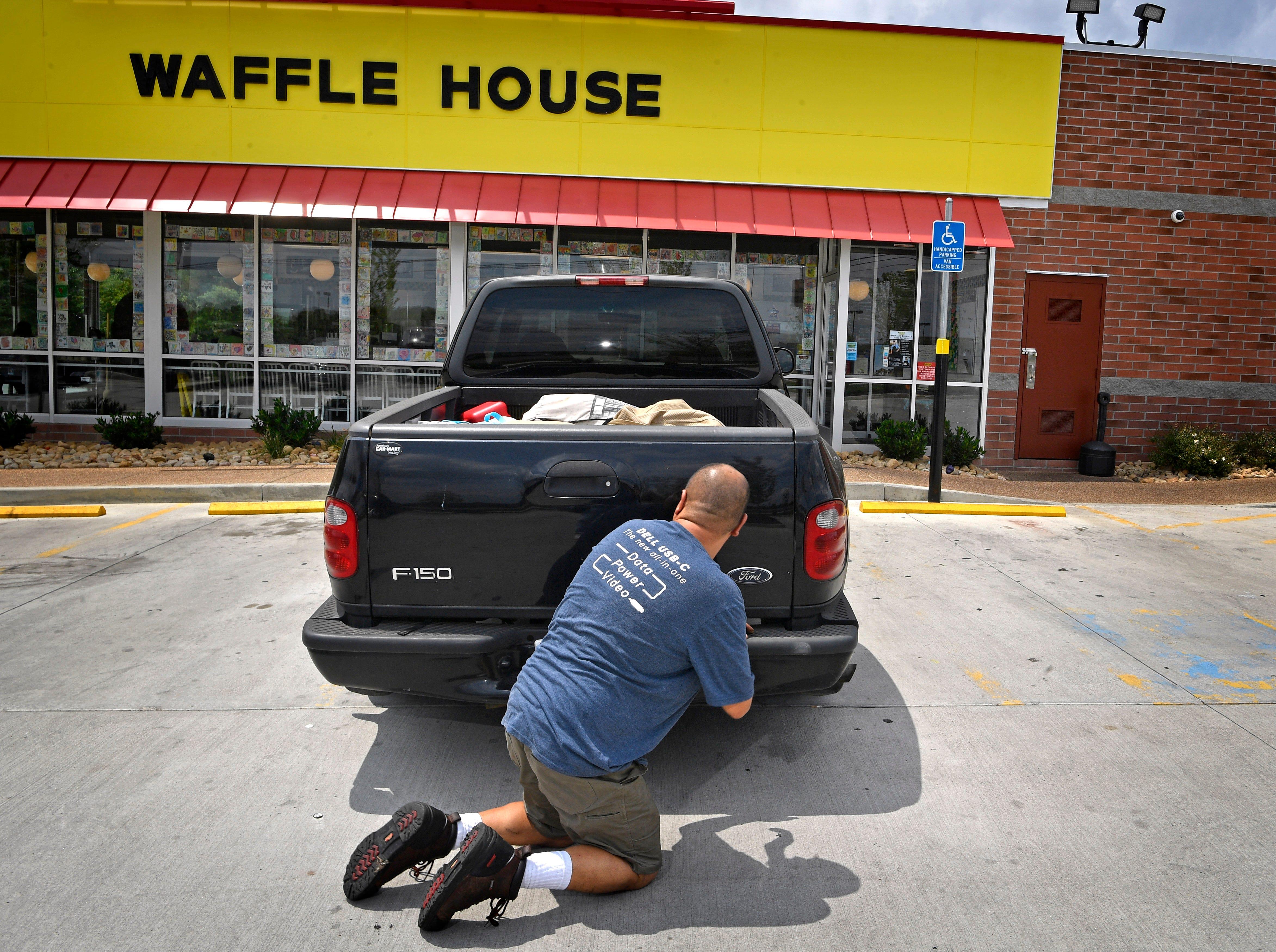 Chuck Cordero shows where he hid on the night four people lost their lives at the Waffle House.