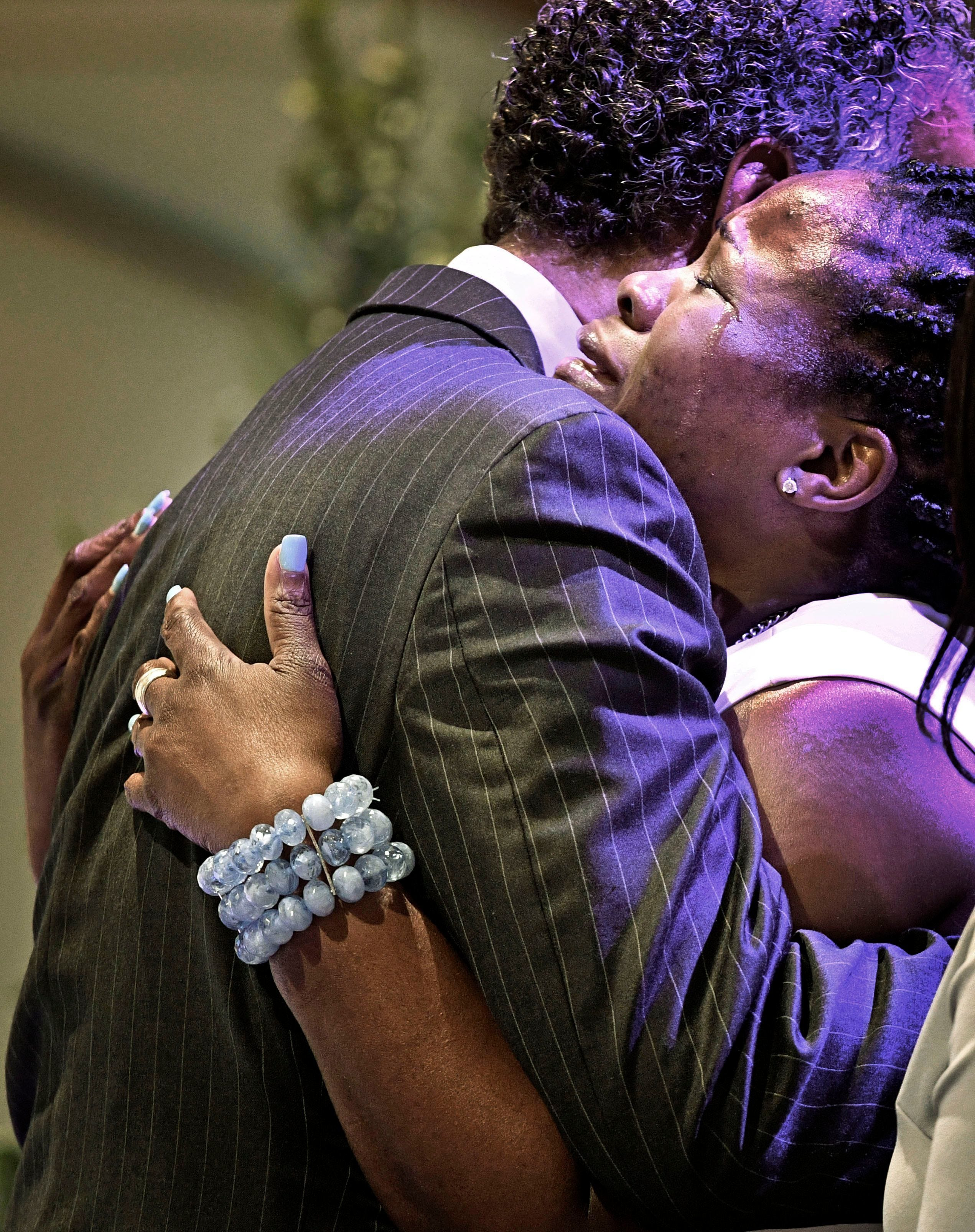 Tears flow down the cheeks of Shaundell Brooks, mother of Waffle House shooting victim Akilah Dasilva, as the casket is closed at his funeral May 5, 2018, at Olive Branch Church in Nashville.