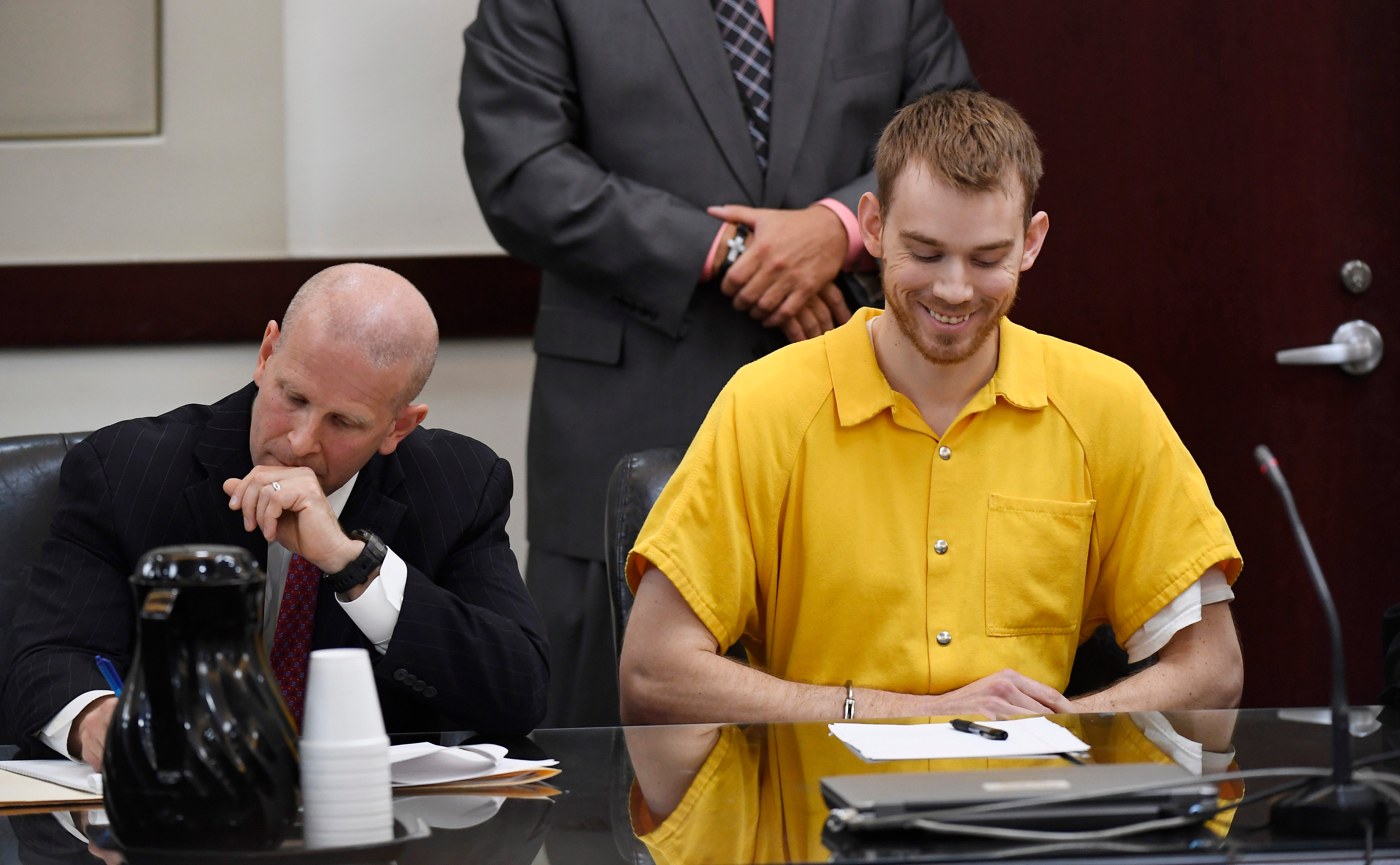 Waffle House shooting suspect Travis Reinking laughs when the judge asks a question during a hearing on his mental health Aug. 22, 2018.