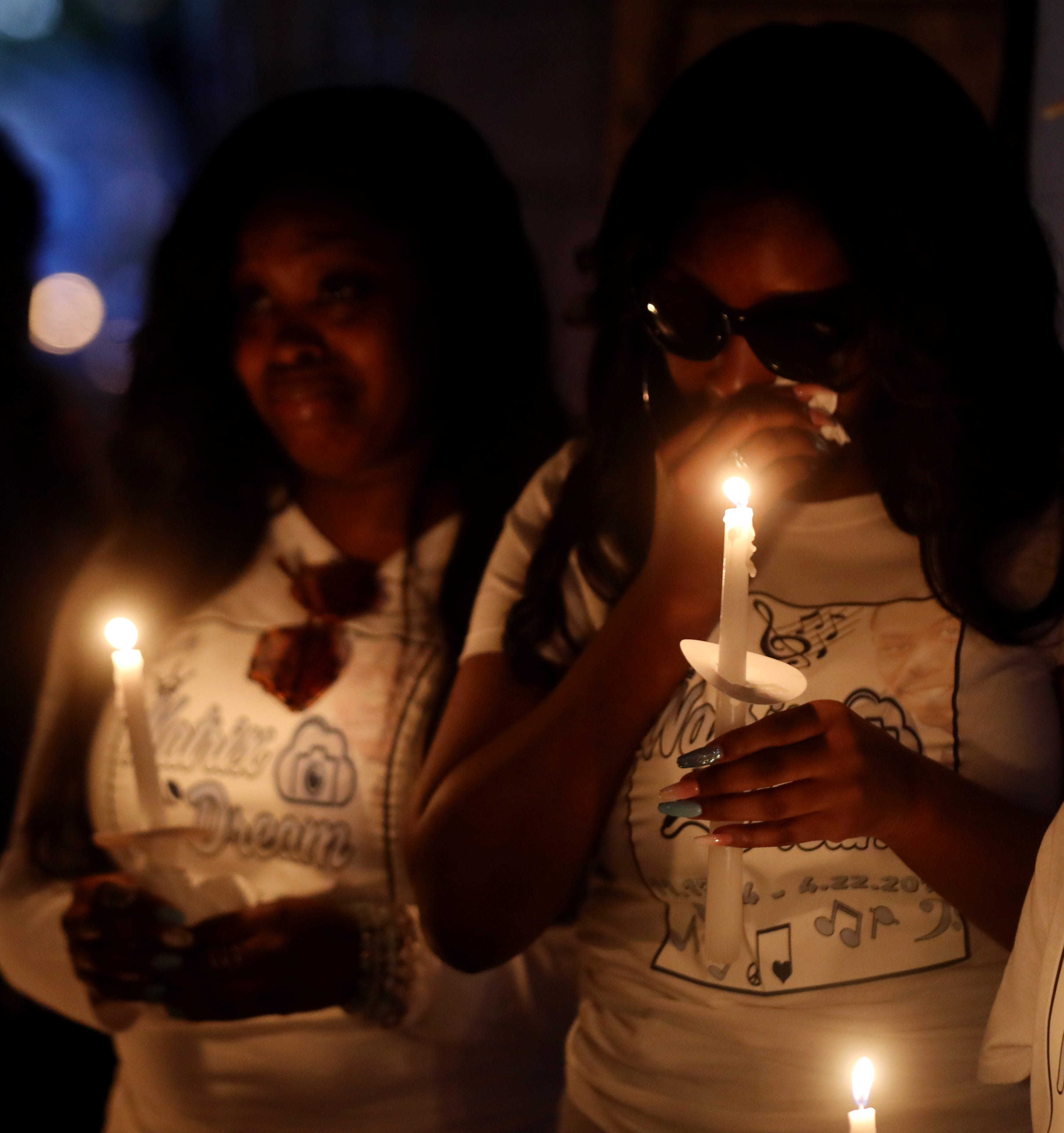 Mourners participate in a candlelight vigil for Waffle House shooting victim Akilah Dasilva on April 26, 2018, in Centennial Park. Dasilva died after being shot in the right shoulder and right lung.