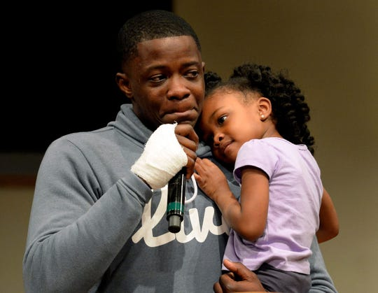 James Shaw Jr. holds his daughter, Brooklyn, 4, while speaking during a prayer vigil in April at Mount Zion Baptist Church in Antioch. Hundreds of civic leaders and residents attended the vigil for those affected by the Waffle House shooting.