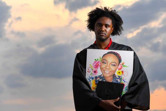 Di'Angelo Groves holds a portrait of his sister DeEbony, a Waffle House shooting victim, on July 30, 2018. The two worked together and were scheduled to graduate from Belmont University together a couple of weeks after the shooting.