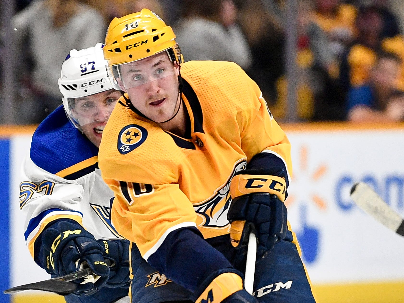 Nashville Predators center Colton Sissons (10) skates past St. Louis Blues left wing David Perron (57) during the third period at Bridgestone Arena in Nashville, Tenn., Wednesday, Nov. 21, 2018.