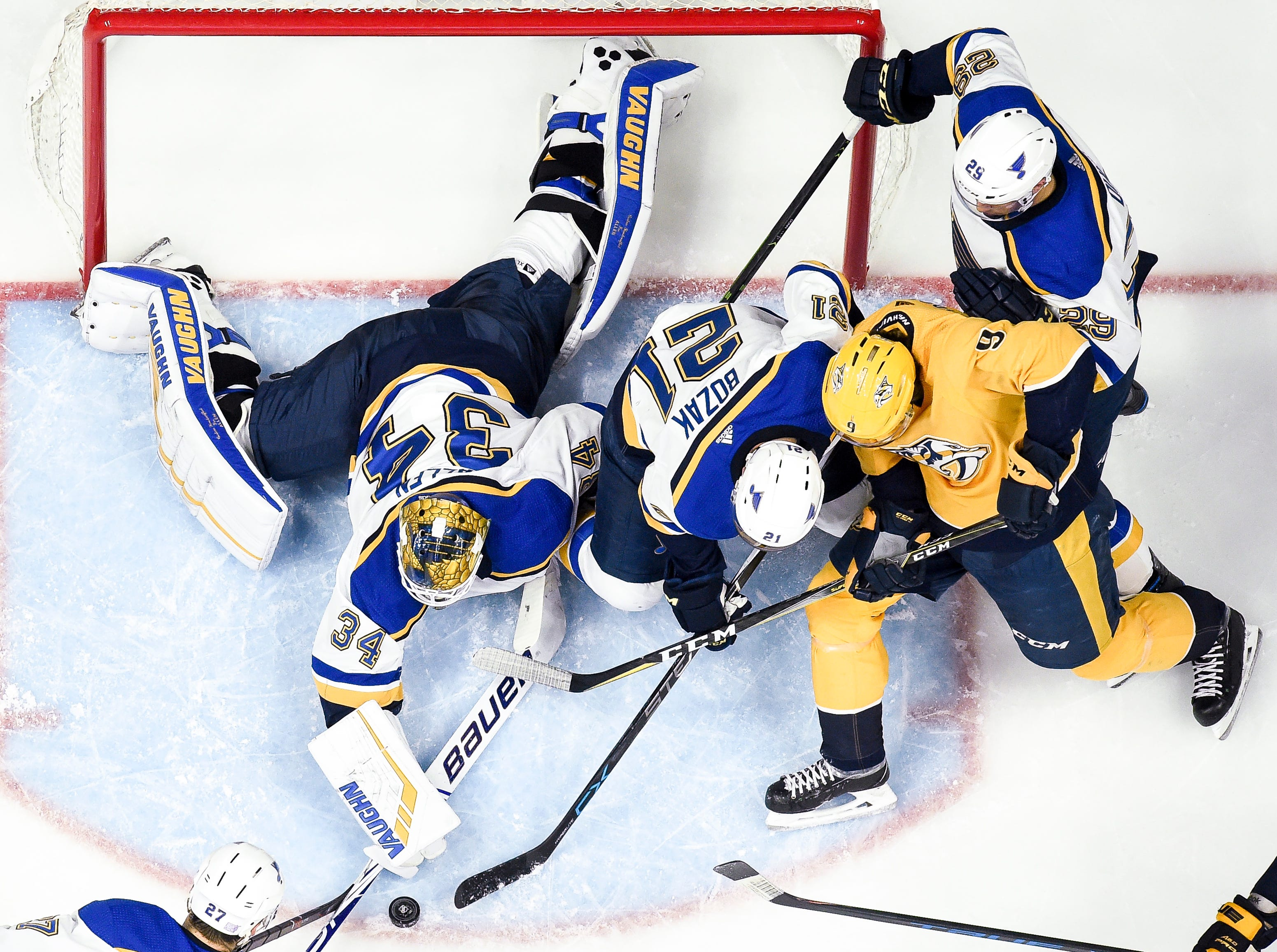St. Louis Blues goaltender Jake Allen (34), center Tyler Bozak (21), and defenseman Vince Dunn (29), defend against Nashville Predators left wing Filip Forsberg (9) during the second period at Bridgestone Arena in Nashville, Tenn., Wednesday, Nov. 21, 2018.
