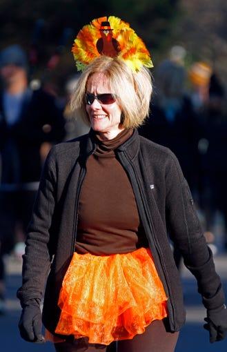 A participant walks along the course during the annual Boulevard Bolt Thursday, Nov. 22, 2018, in Nashville, TN.