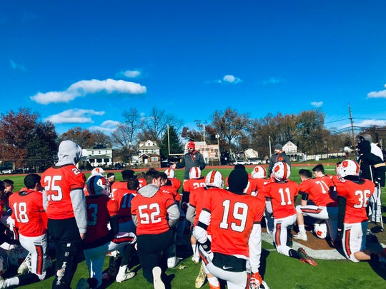 Dumont coach Rick Burd congratulates his team after its Thanksgiving win over Tenafly.