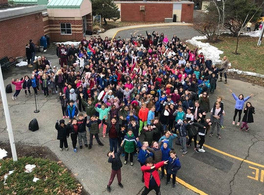 Overhead photo of kids at the Pines Lake School after Turkey Trot.