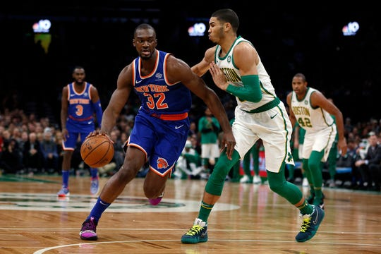 Boston, MA, USA; New York Knicks forward Noah Vonleh (32) is guarded by Boston Celtics forward Jayson Tatum (0) during the first half at TD Garden.