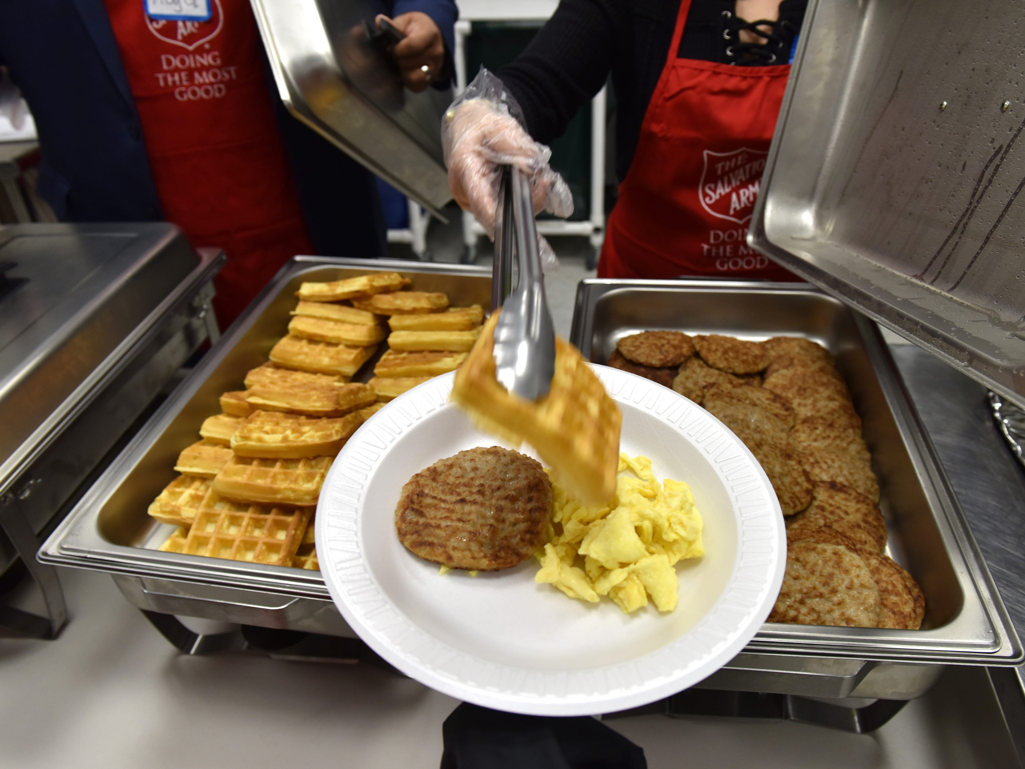 Volunteers with the Salvation Army and Eastwick College serve breakfast on Thanksgiving day in Hackensack on Thursday morning November 22, 2018.