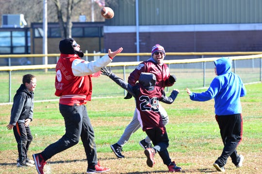 Fathers play against their sons in an annual football game in Emerson on Thursday morning November 22, 2018. Third grade boys beat their fathers in an annual game that ended 21-14.