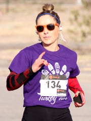 "Dolores ""Lola"" Cisneros, a Deming teacher, won the women's 3-mile trot in 20:09."