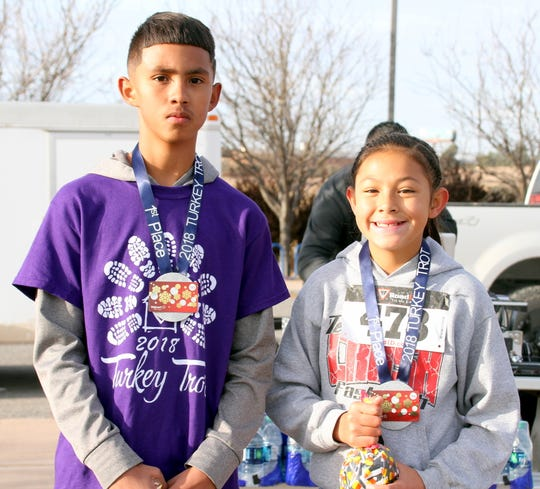 The winners of the kids' 1-mile fun run were Miguel Del Rio and Alexis Reyes.