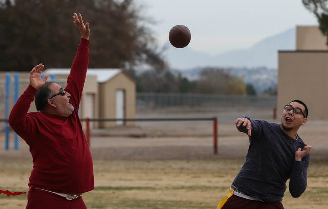 Victor Ray Martinez throws a pass, as Gonzalo Soto attempts to block it, during the Ortiz Family Annual Thanksgiving Day football game on Thursday, Nov. 22, 2018 at Zia Middle School.