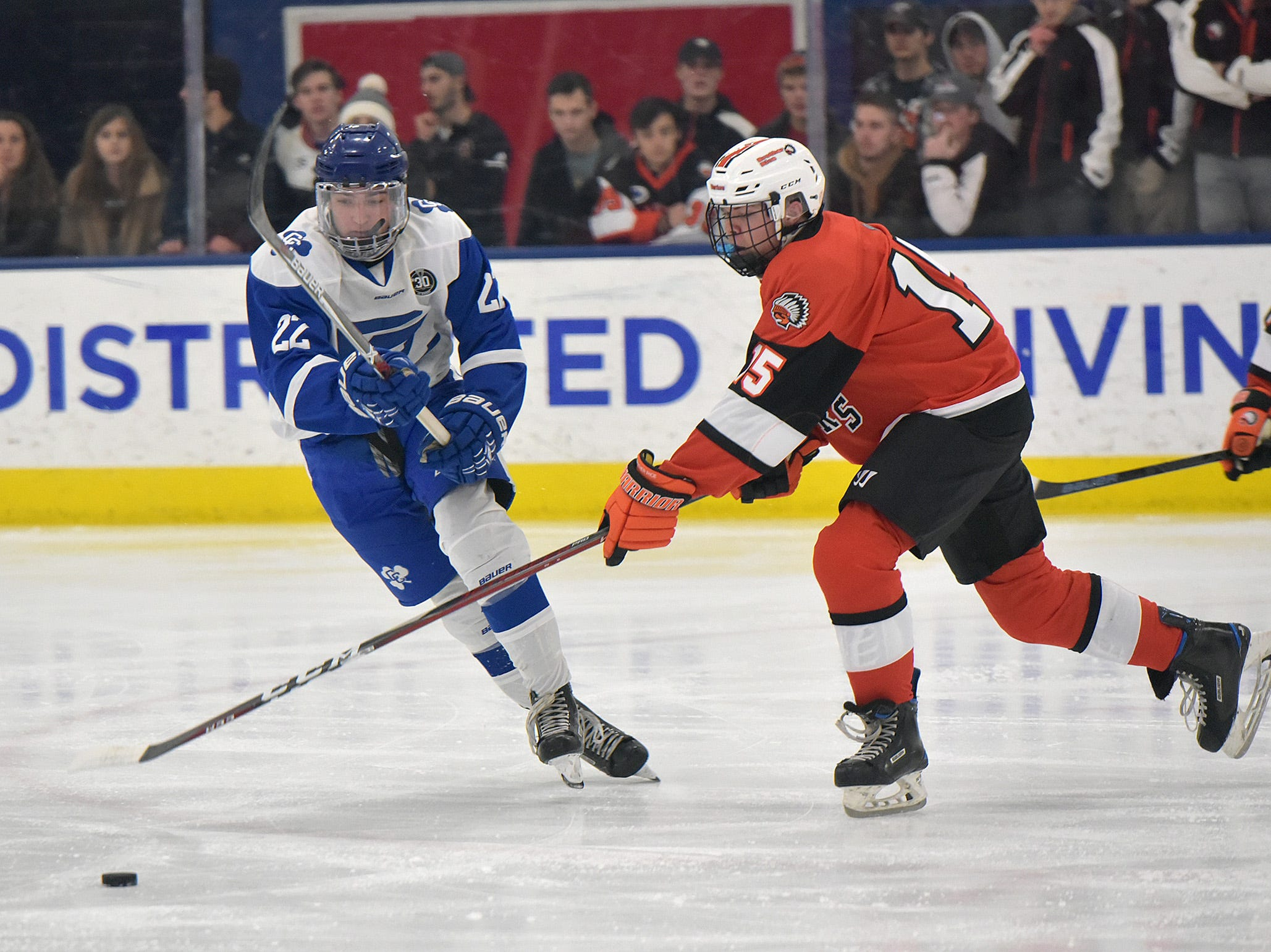 Brother Rice Nick Dippre (15) slips the puck past CC's Ryan Pearson (22).
