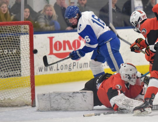 CC forward Dylan Dooley (16)  slips the puck past Rice goalie Cooper Duncan (1) for a goal.