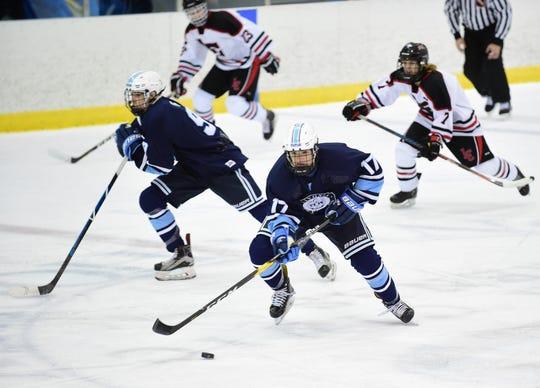 Stevenson's Jaydon Spears heads up the ice during the Thanksgiving Eve battle against Churchill.