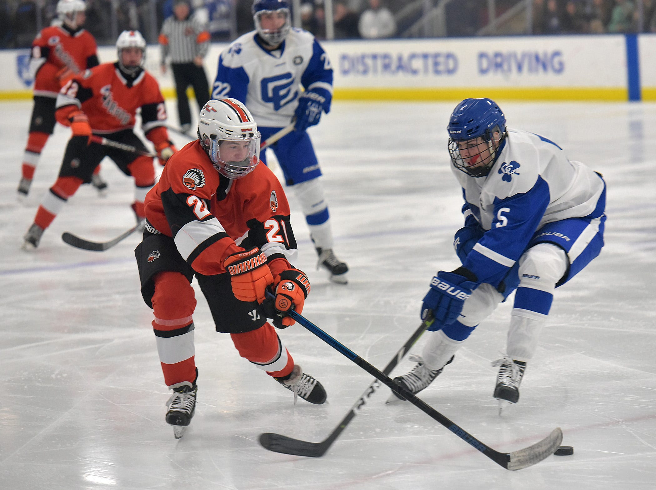 Brother Rice Warrior Ryan Murphy heads for the CC goal. CC defenseman Gordie Husted stops the drive.