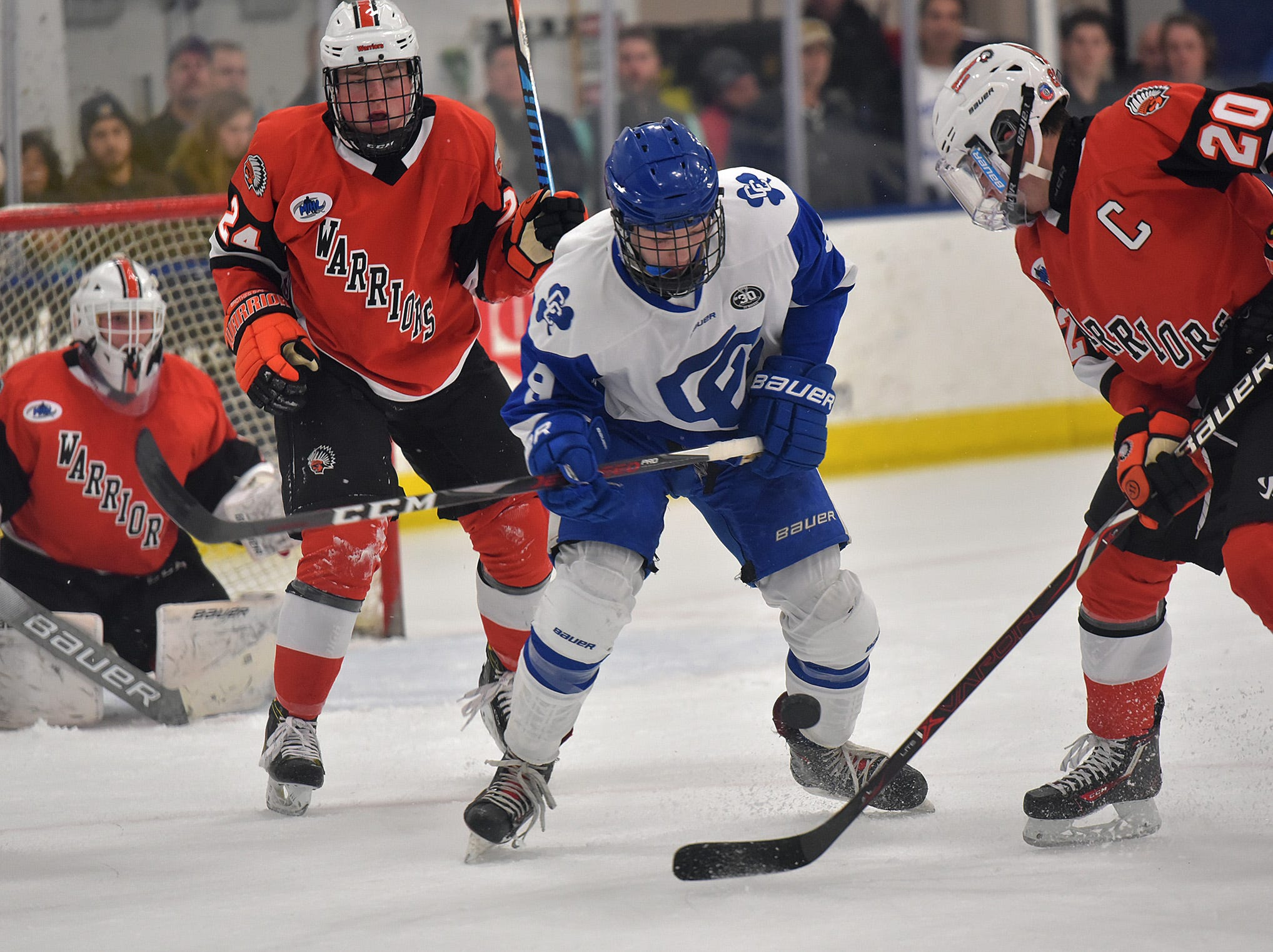 CC's forward Blake Salamon (9) and Rice defense Chris Andoni (20) battle for the puck in front of the Rice net.