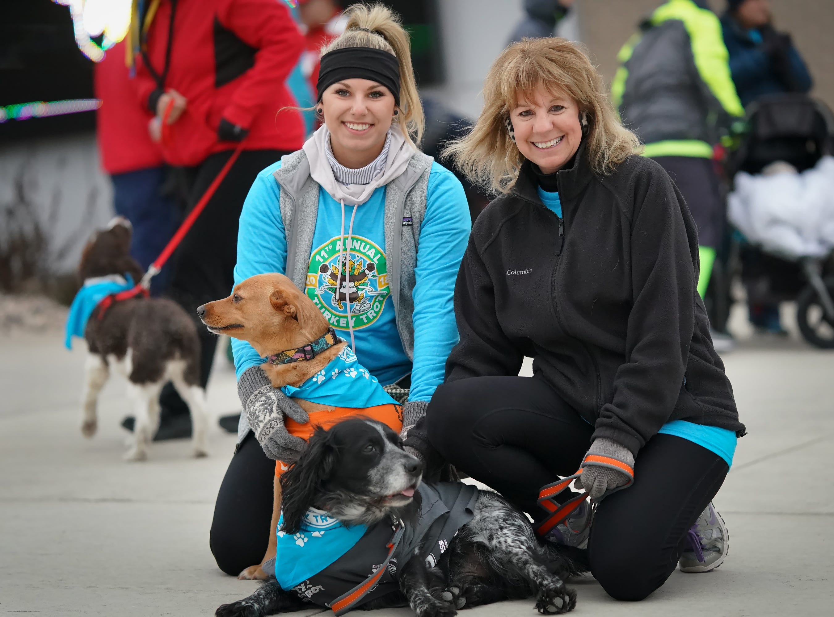 Emily and  Sue Gauger with dogs Boomer and Saide wait for the start of the race. The 11th Annual Festival Foods Turkey Trot was held Thursday morning, November 22, 2018 at the Menominee Nation Arena in Oshkosh.