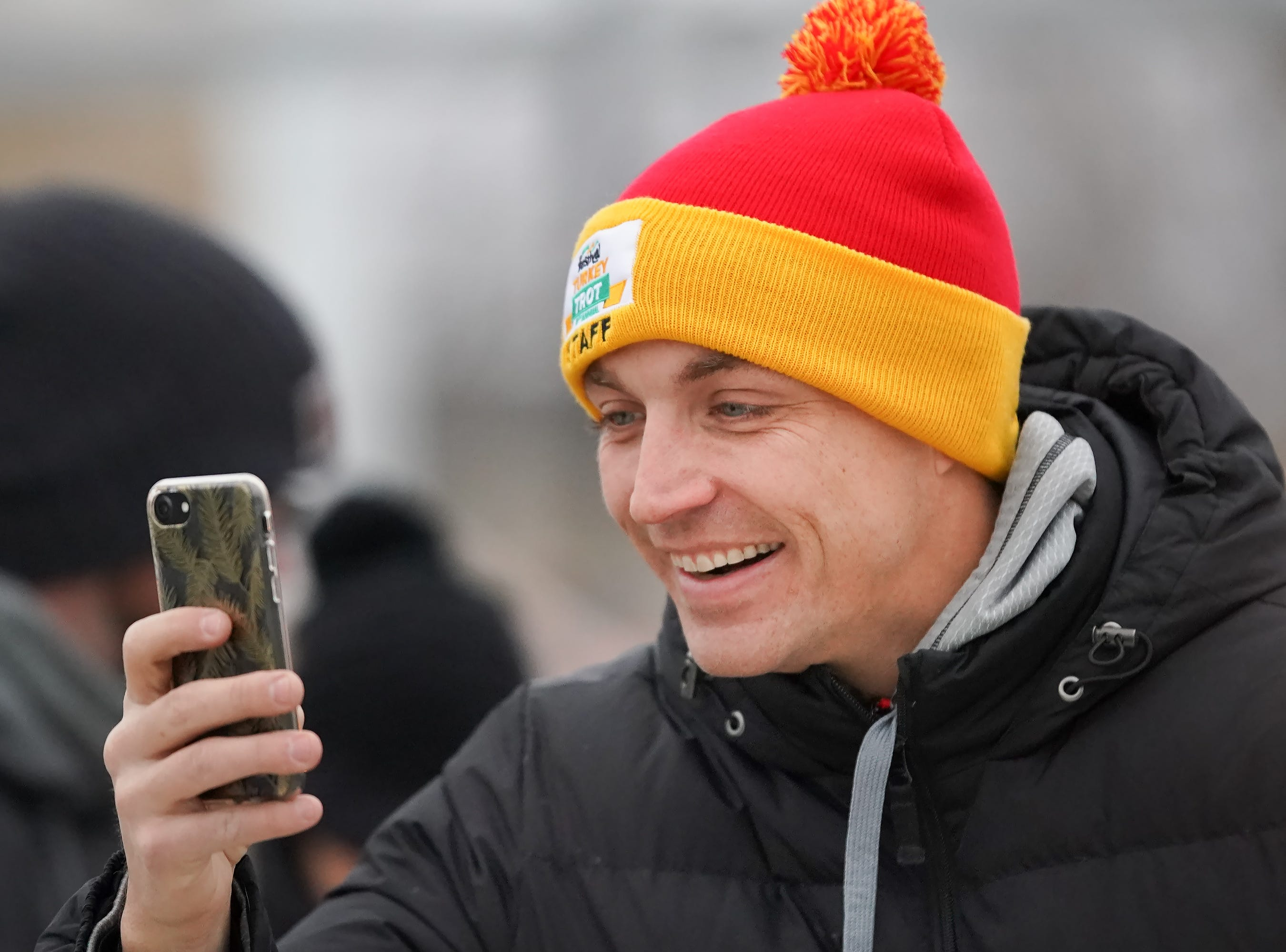 Jacob Crowe takes a photo of a group of runners before the race. The 11th Annual Festival Foods Turkey Trot was held Thursday morning, November 22, 2018 at the Menominee Nation Arena in Oshkosh.