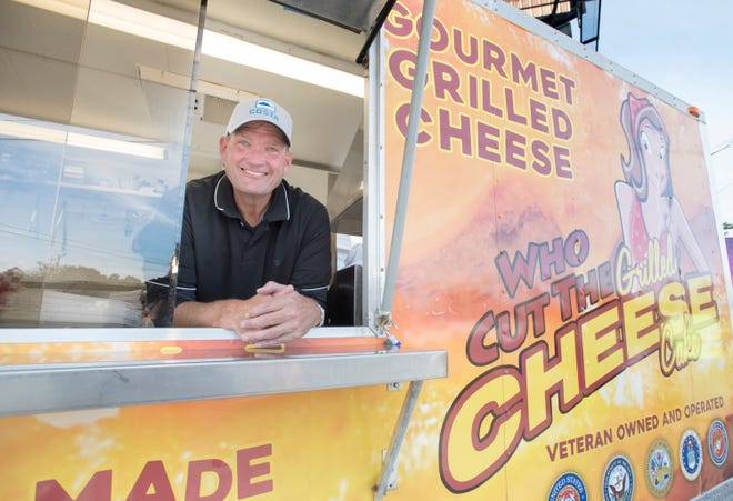 Chris Mann, owner of Who Cut the Grilled Cheese & Cake, in his food truck on New Warrington Road in Pensacola on Wednesday, November 21, 2018.