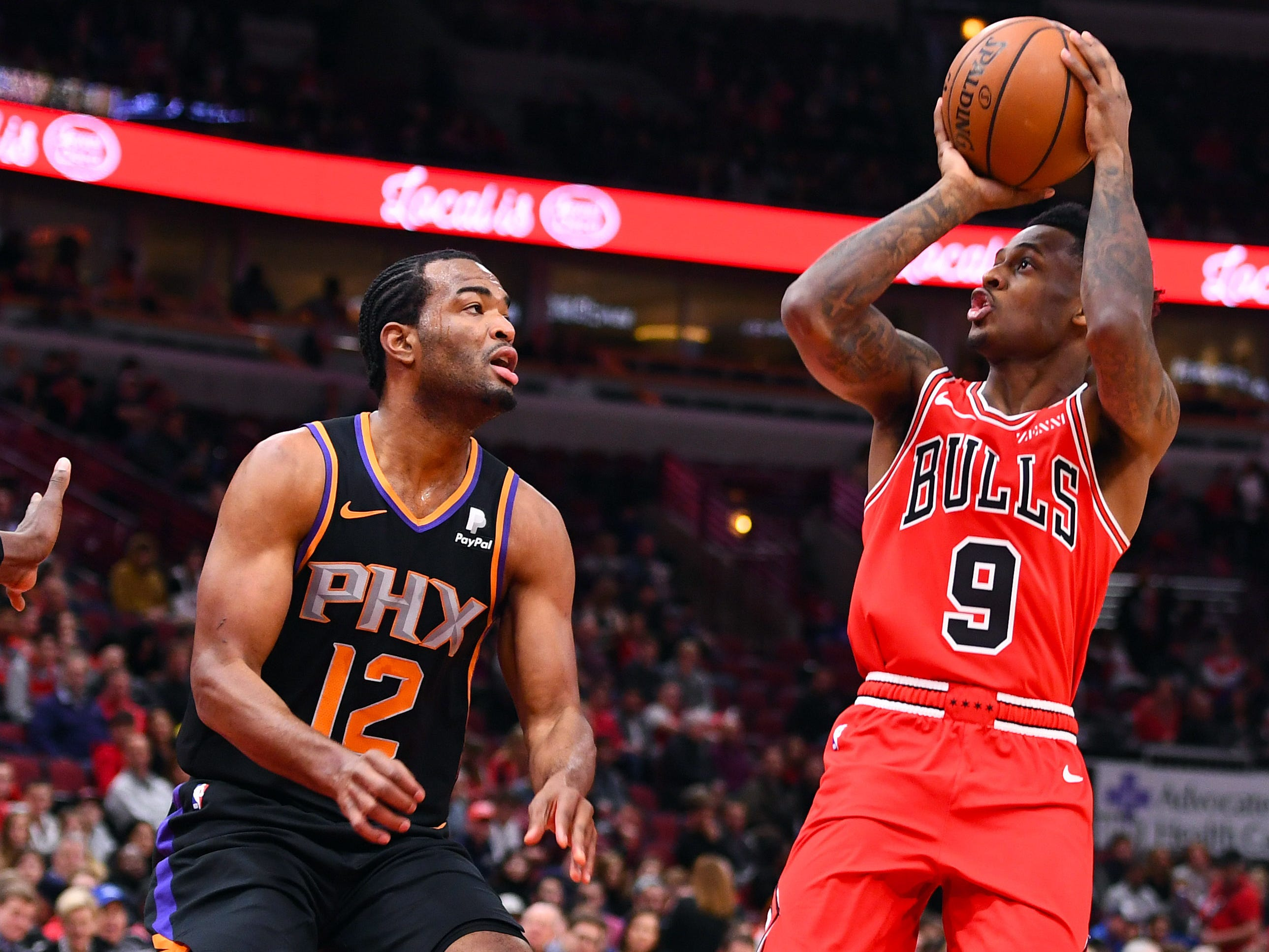 Bulls guard Antonio Blakeney (9) shoots the ball against Suns forward TJ Warren (12) during the first half of a game Wednesday at the United Center.