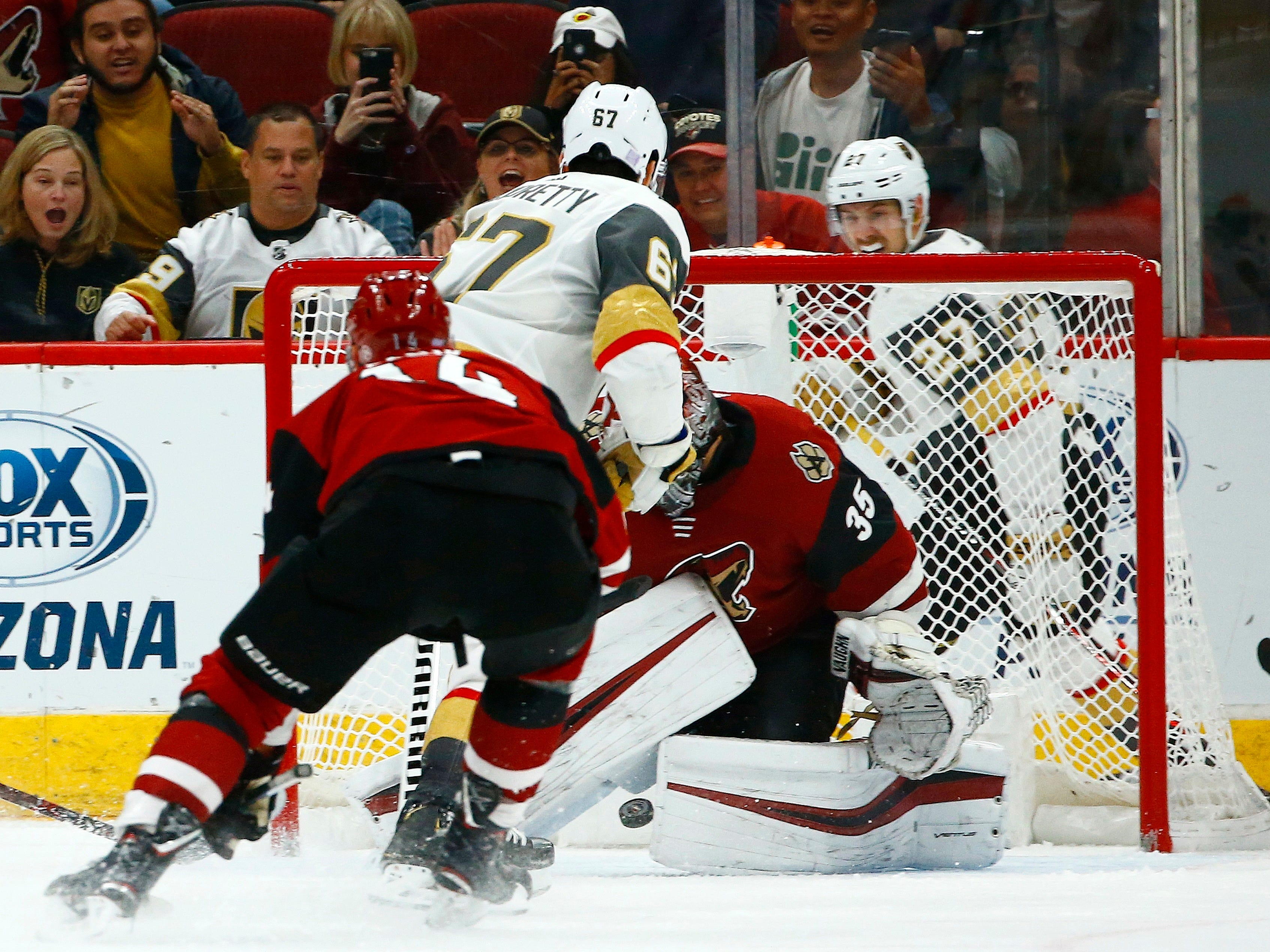 Golden Knights left wing Max Pacioretty (67) scores against Coyotes goaltender Darcy Kuemper in overtime of a game Nov. 21 at Gila River Arena.