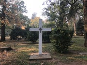 A white cross at Paradise Cemetery