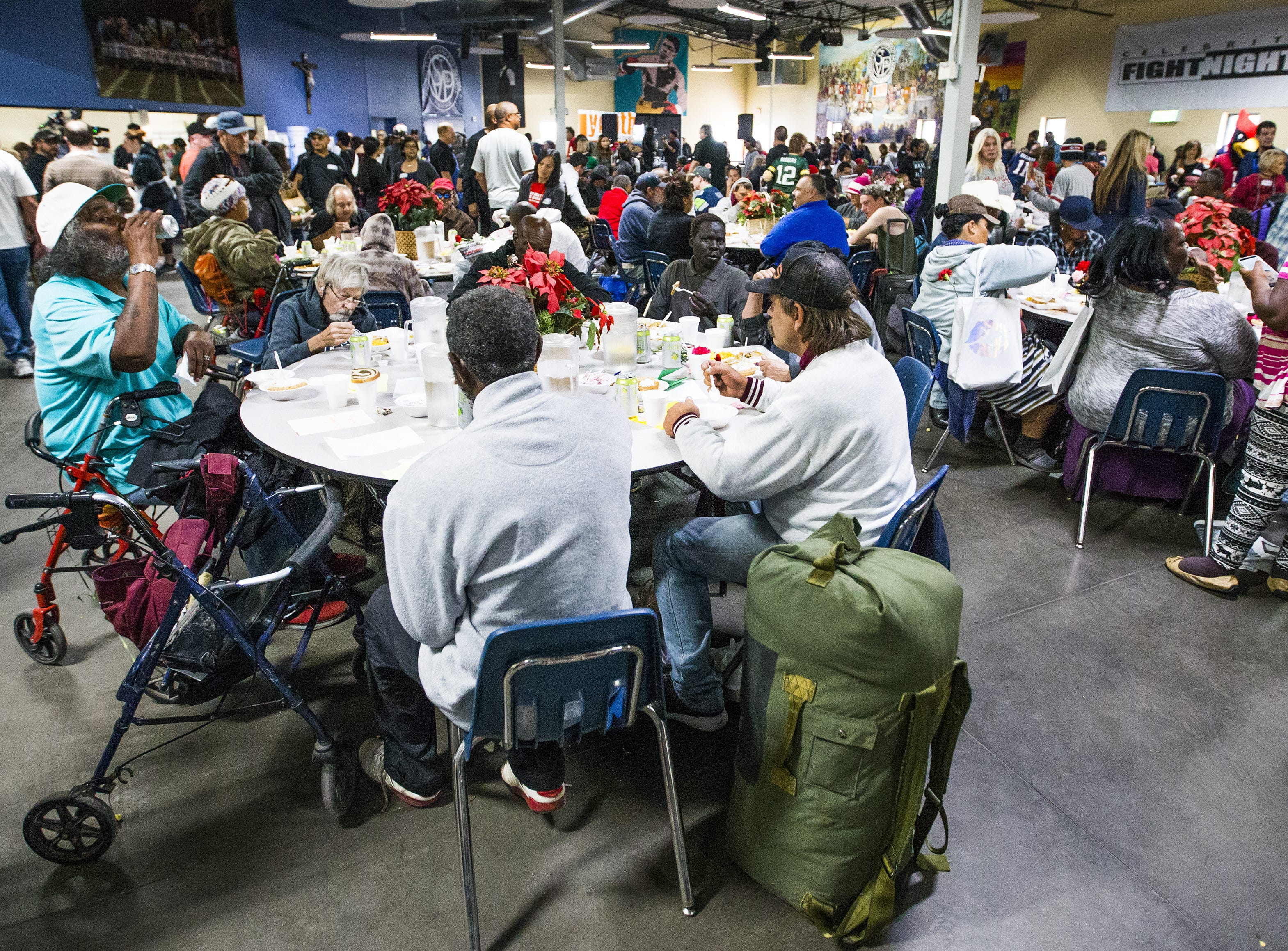 Hundreds enjoy a Thanksgiving Day meal served by volunteers at the St. Vincent de Paul Society Human Services Campus Dining Room in Phoenix, Thursday, November 22, 2018.   Turkey, mashed potatoes and pumpkin pie were on the menu.