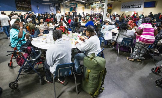 Hundreds enjoy a Thanksgiving Day meal served by volunteers at the St. Vincent de Paul Society Human Services Campus Dining Room in Phoenix last year. St. Vincent de Paul is one of the organizations that has received Season for Sharing grants in past years.