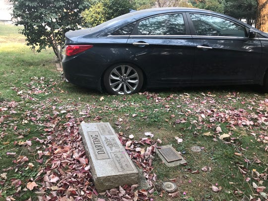 A car was left abandoned over a headstone at the Paradise Cemetery in California.