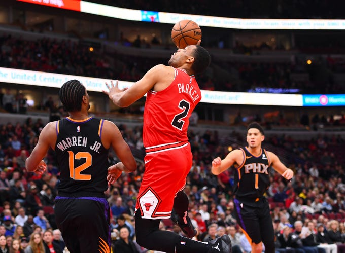 Bulls forward Jabari Parker shoots over Suns forward TJ Warren during the first half of a game Nov. 21 at the United Center.