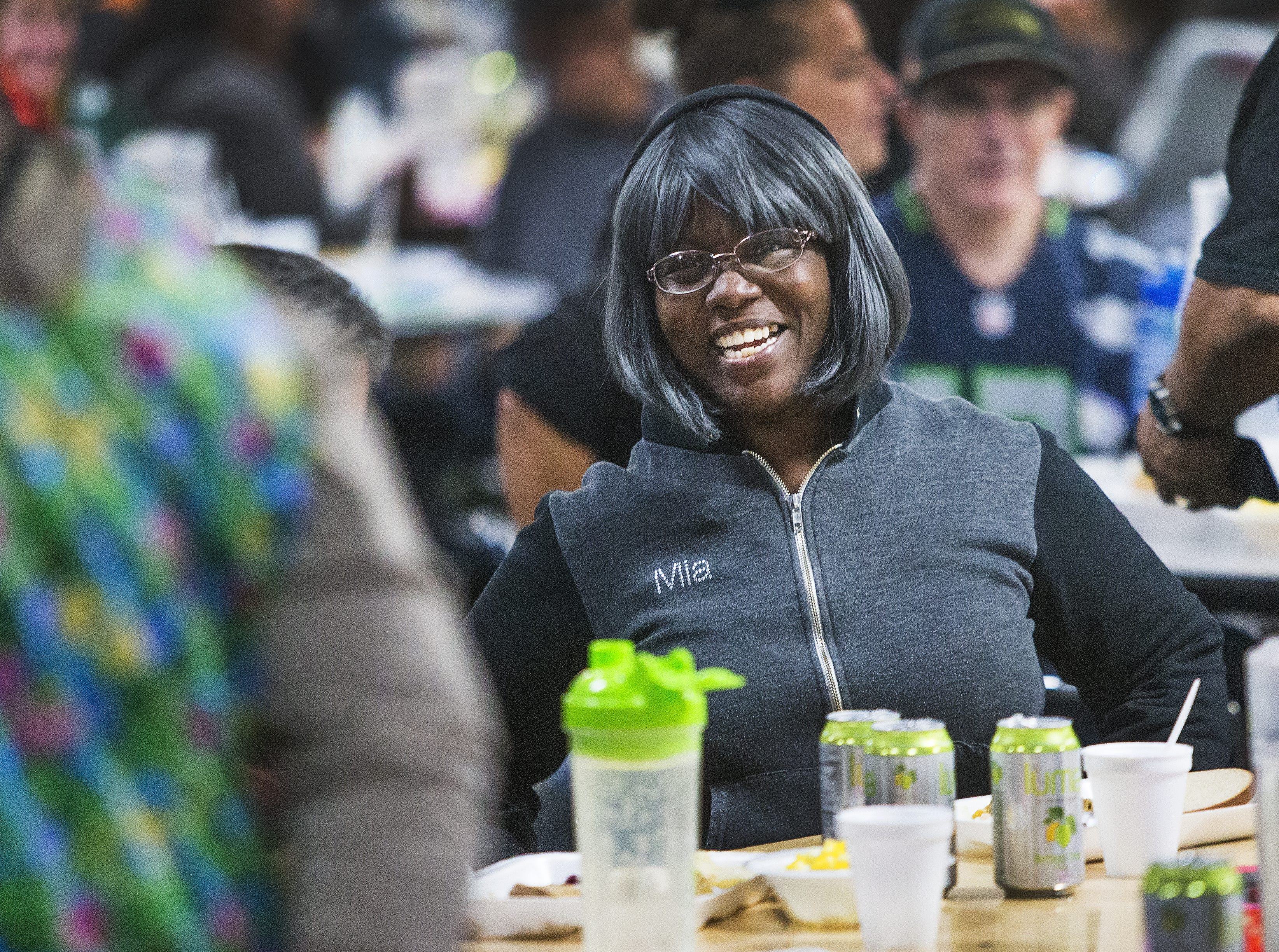 Khadijah Amatullah enjoys the music at the Thanksgiving Day meal served by volunteers with the St. Vincent de Paul Society. Hundreds enjoyed turkey, mashed potatoes and pumpkin pie at the Human Services Campus Dining Room in Phoenix, Thursday, November 22, 2018.