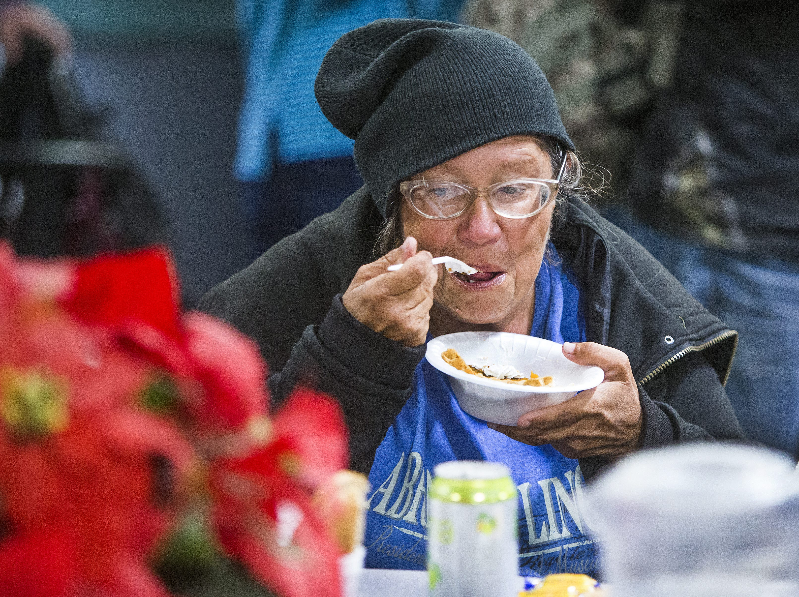 Dianal Tripp enjoys some pumpkin pie at the Thanksgiving Day meal served by volunteers with the St. Vincent de Paul Society. Hundreds enjoyed turkey, mashed potatoes and pumpkin pie at the Human Services Campus Dining Room in Phoenix, Thursday, November 22, 2018.