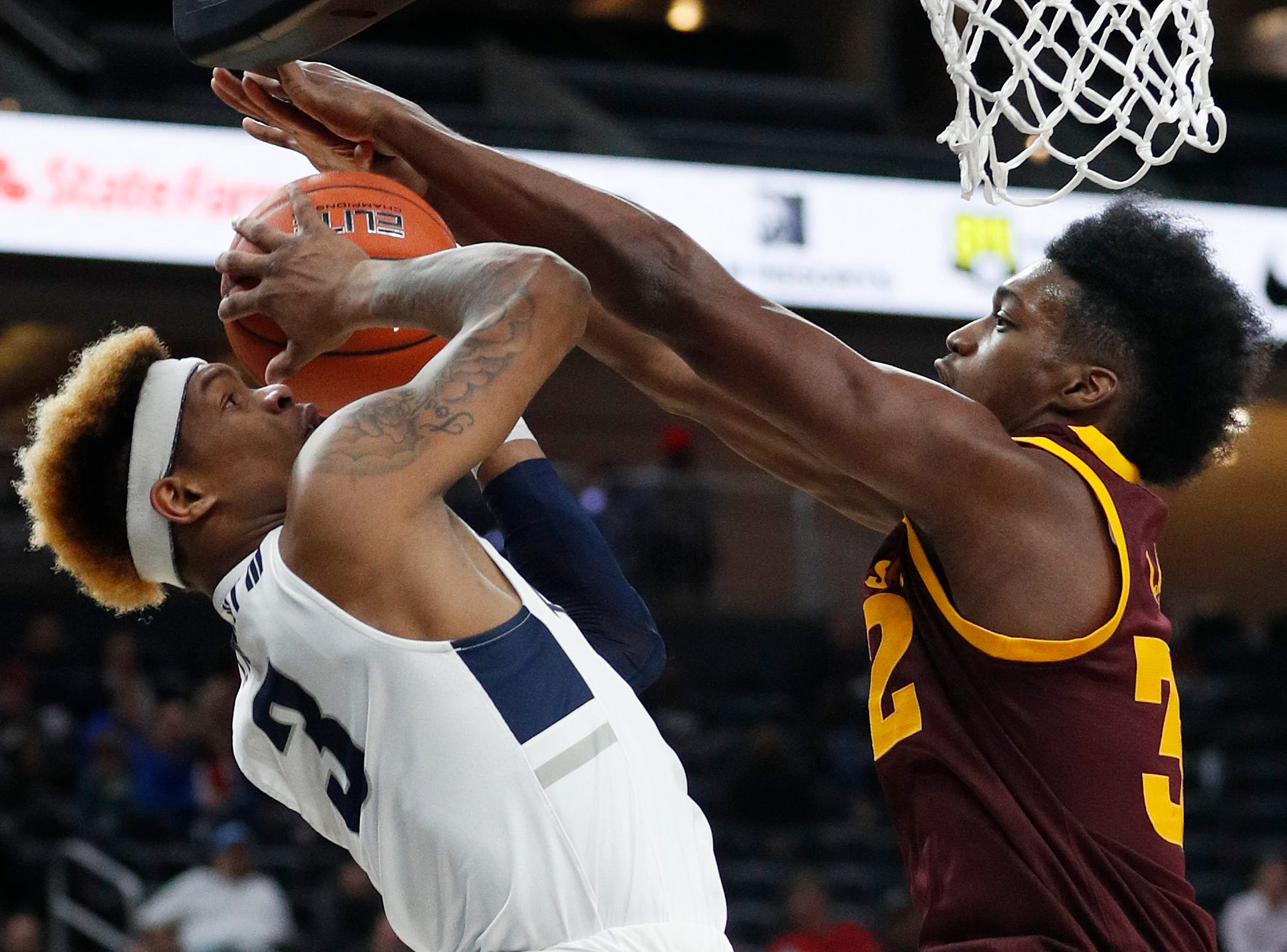 Arizona State's Romello White blocks a shot by Utah State's John Knight III during the first half of the MGM Resorts Main Event Tournament championship game.