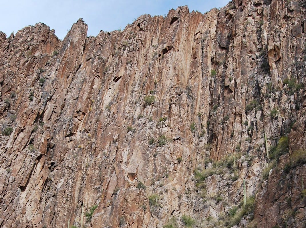 A hiker at the base of the LaBarge narrows walls in Arizona's Superstition Mountains.
